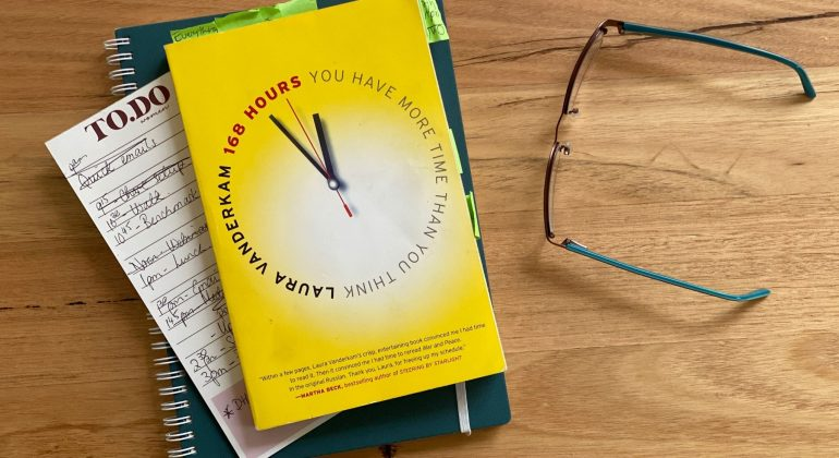 """""""168 Hours"""" book on table"""